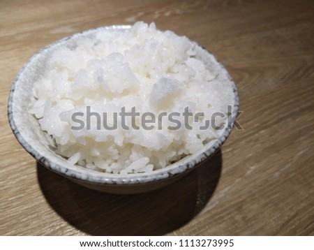 Japanese cooked rice in white bowl on table. #1113273995