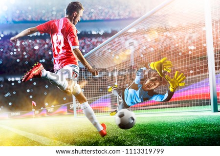 Goalkeeper catches the ball on the soccer stadium Royalty-Free Stock Photo #1113319799