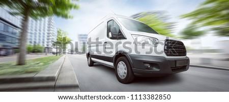 Van traveling in the city #1113382850