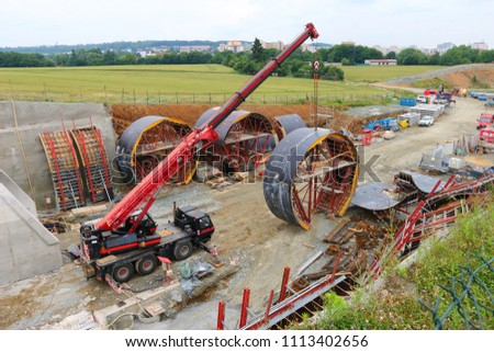 PILSEN / CZECH REPUBLIC - JUNE 14, 2018: Tunnel boring machine at railroad construction site. Building of new high speed track to Germany.  #1113402656