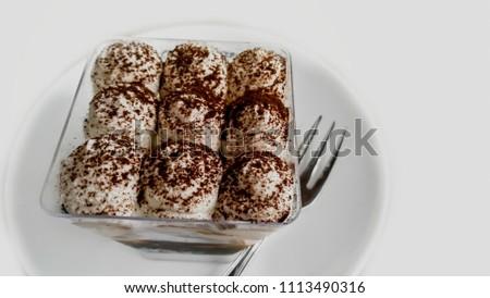 Cake with cream, food. Cake slice on white plate in paris, france, dessert. Temptation, appetite concept. Dessert, food, snack, pastry. Cuisine, menu, dish, recipe #1113490316