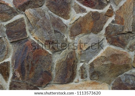 Texture is a stone wall close-up #1113573620