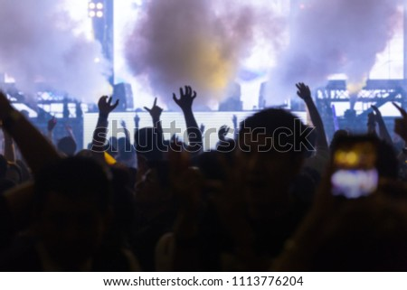 Effects blur Concert, disco dj party. People with hands up having fun  #1113776204