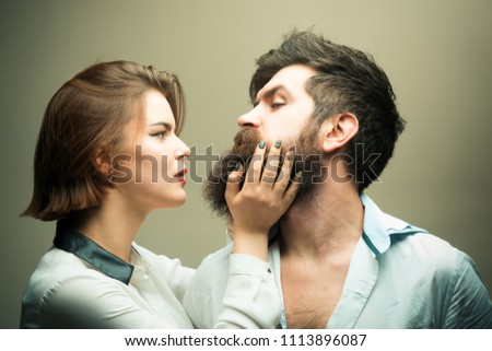 Woman hairdresser making shape of beard, touches. Man with long beard, mustache and stylish hair, light background. Guy with modern hairstyle visited hairdresser. Barbershop or hairdresser concept. #1113896087