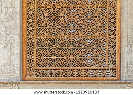 ISFAHAN, IRAN - MAY 8, 2015: Beautiful detail of the wooden window in the Chehel Sotoun palace for entertainment and receptions. #1113916133