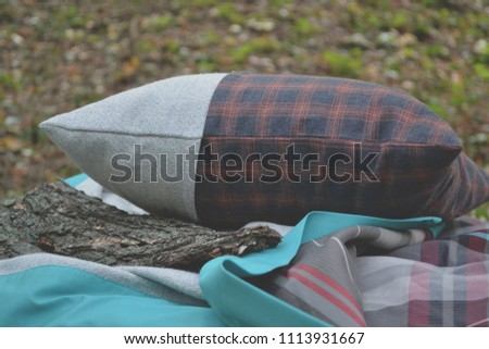 Pillow and plaid outdoor. #1113931667