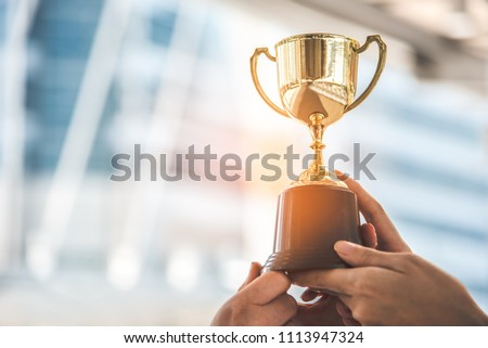 Champion golden trophy for winner background. Success and achievement concept. Sport and cup award theme. #1113947324