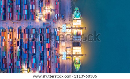 Container ship in export and import business and logistics. Shipping cargo to harbor by crane. Water transport International. Aerial view and top view. #1113968306