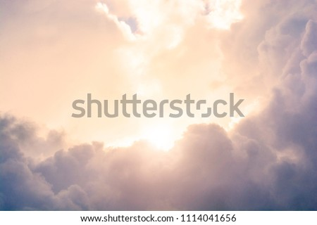 The sun's rays make their way through the clouds. Heaven's heaven. Paradise. Peace and tranquility. Royalty-Free Stock Photo #1114041656