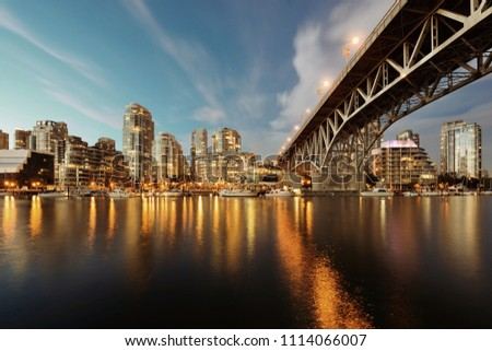 Vancouver False Creek at night with bridge and boat. #1114066007