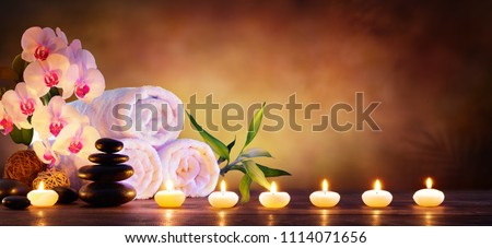 Spa Concept - Massage Stones With Towels And Candles In Natural Background  #1114071656