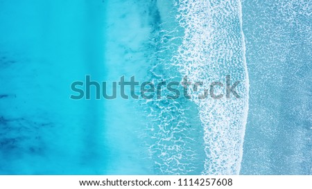 Wave on the beach as a background. Beautiful natural background at the summer time #1114257608