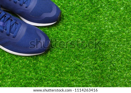 Sport shoes on grass #1114263416