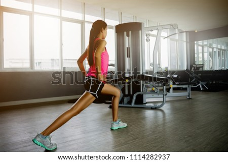 Strong woman relaxing working out  with her exercise in the fitness room. #1114282937