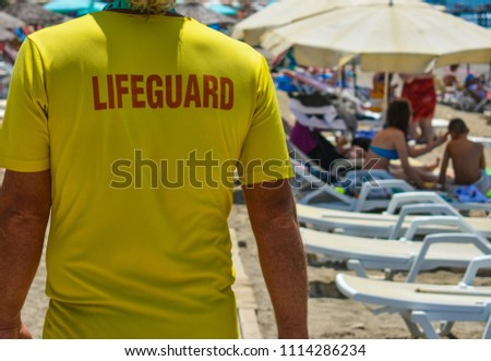 Lifeguard on the beach controls safe swimming #1114286234