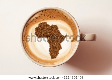 Cup of cappuccino with a picture of Africa