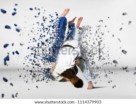 Battle of two fighters judo sports judo competitions Royalty-Free Stock Photo #1114379903