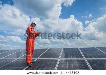 operation and maintenance in solar power plant ; engineering team working on checking and maintenance in solar power plant ,solar power plant to innovation of green energy for life #1114415102