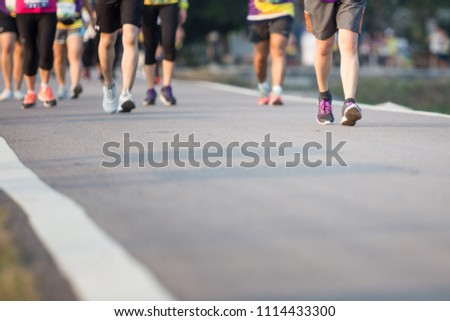 Group of people running race marathon #1114433300