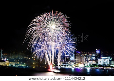 Cityscape of night skyline Pattaya City and Colorful fireworks. Celebration and anniversary concept. Pattaya International Fireworks Festival 2018 at Pattaya beach  on twilight background, Thailand. #1114434212