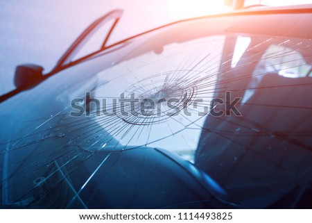 Automobile special workers remove old windscreen or windshield of a car in auto service station garage. Background Royalty-Free Stock Photo #1114493825