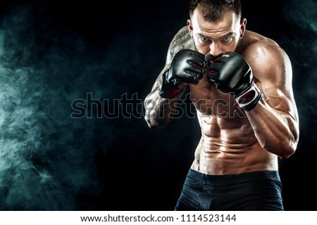 Sportsman boxer fighting on black background. Copy Space. Boxing sport concept. Royalty-Free Stock Photo #1114523144