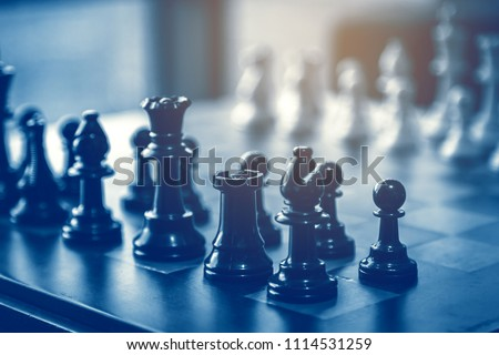business  game competitive strategy with chess board game with blur background Royalty-Free Stock Photo #1114531259