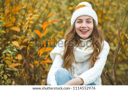 Young attractive woman in autumn colorful background #1114552976