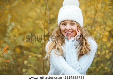 Young attractive woman in autumn colorful background #1114552985