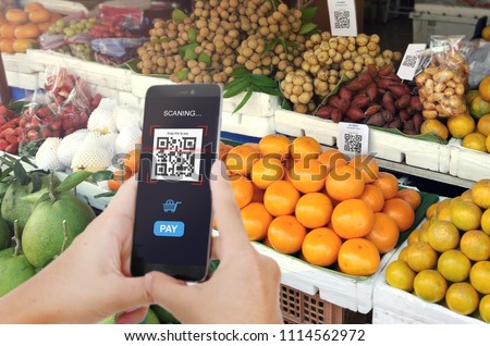 Qr code payment, E wallet , cashless technology concept. Man scanning tag Fresh Fruit in Market accepted generate digital pay without money. #1114562972