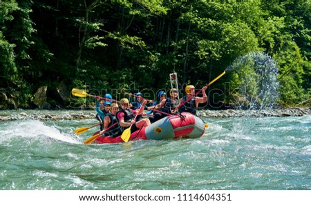 rafting on a mountain river #1114604351