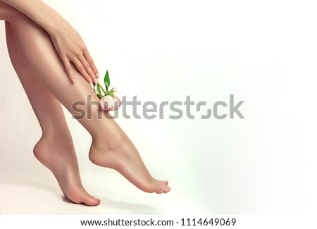 Beautiful well-groomed female legs . Foot care . Depilation of hair on the feet .  #1114649069