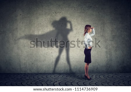 Side view of a business woman imagining to be a super hero looking aspired.  Royalty-Free Stock Photo #1114736909