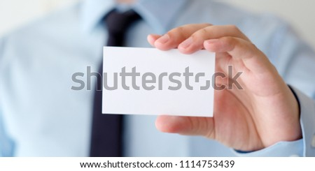 Businessman hand holding blank white business card with copy space for text, business mock up background concept  #1114753439