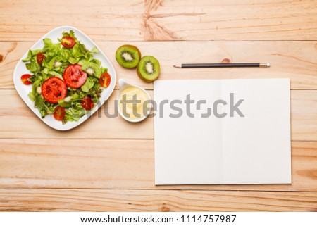 Flat lay, top view healthy fresh fruit salad with a note on a wooden table #1114757987
