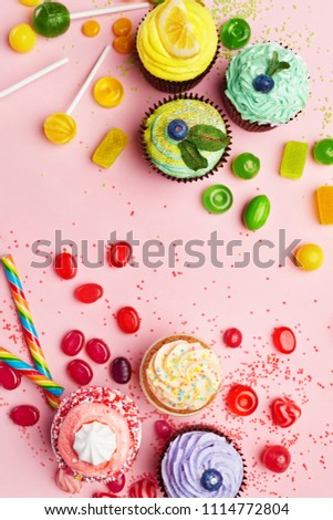 Sweets. Candy And Cupcakes On Pink Background #1114772804