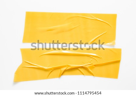 Set of yellow tapes on white background. Torn horizontal and different size yellow sticky tape, adhesive pieces. #1114795454