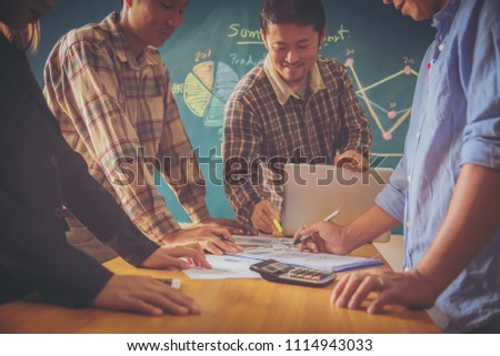 Business meeting, man's hands pointing on charts. Reflection light and flare. Concept image of data gathering and statistical working. #1114943033