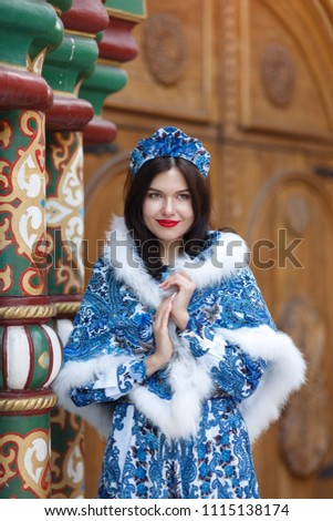 Girl model in Russian folk dress on the FIFA World Cup in Russia 2018. #1115138174