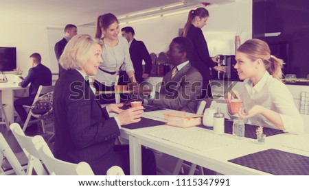 business partners drink coffee and communicate at a break in the office #1115347991