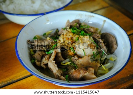Boiled pork and pig liver in a bowl ,Served with delicious hot steam rice. Thai food. #1115415047