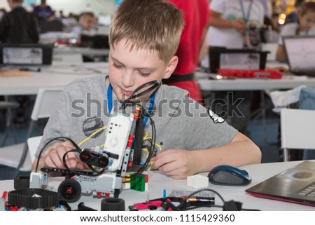 "Minsk, Belarus. May, 2018. ""5th Minsk Open Robotics Tournament"". Robotics competitions. Boys and girls construct and code Robot Lego Mindstorms EV3. STEM. #1115429360"