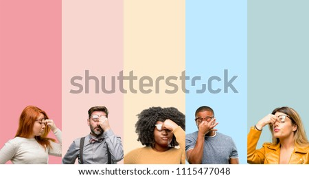 Cool group of people, woman and man with sleepy expression, being overworked and tired, rubbes nose because of weariness #1115477048