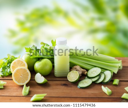 healthy eating, food, dieting and vegetarian concept - bottle with juice, fruits and vegetables on wooden table over green natural background #1115479436