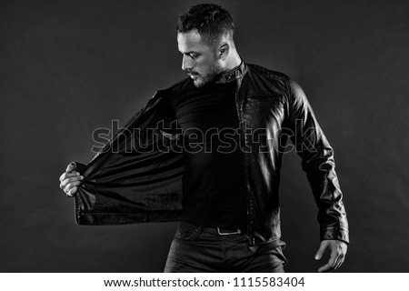 Fashion model in casual style clothes. Bearded man undress leather jacket. Man with beard on unshaven face. Style and trend. Mens sexuality or attraction and charisma, black and white. #1115583404