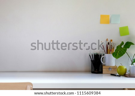 Loft workspace desk with sticky note, house plant and copy space  #1115609384