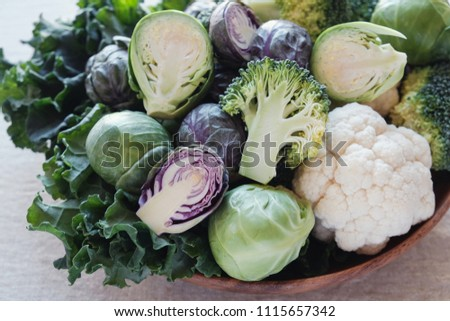 cruciferous vegetables, cauliflower,broccoli, Brussels sprouts, kale in wooden bowl, reducing estrogen dominance, plant based vegan, ketogenic diet #1115657342