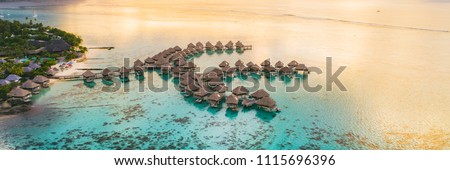 Luxury travel vacation destination panoramic banner. Romantic honeymoon getaway in overwater bungalows villas of Tahiti resort, Bora Bora, French Polynesia. Landscape copy space panorama. Royalty-Free Stock Photo #1115696396