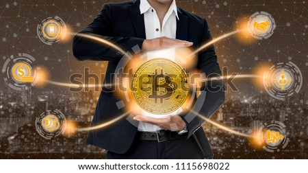 Bitcoin and cryptocurrency investing concept - Businessman holding Bitcoin with mobile application business icons showing exchanging, trading, transfer and investment of blockchain technology. #1115698022