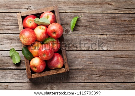 Ripe red apples in wooden box. Top view with space for your text #1115705399